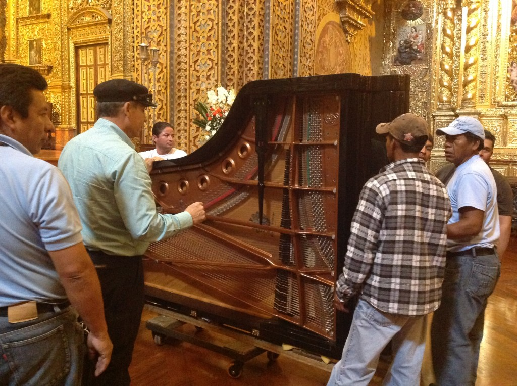 Piano is moved with much care